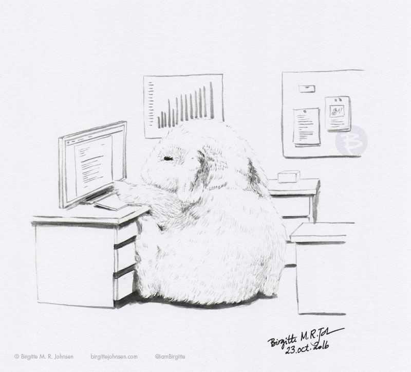 A rabbit sitting in an tiny office working at a fake computer.